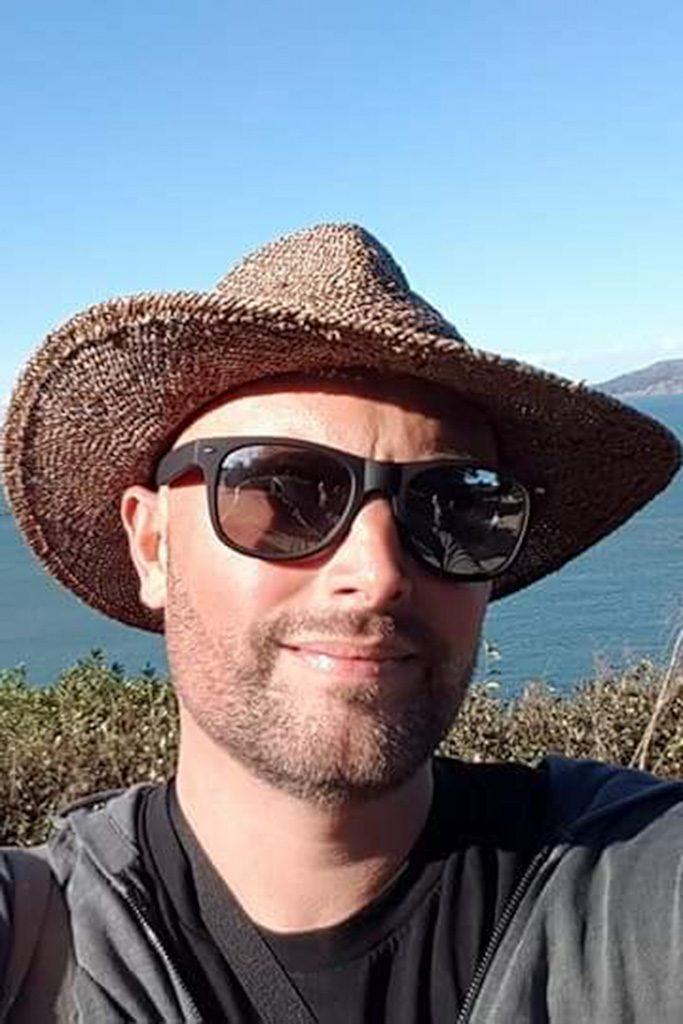 head and shoulder portrait of Revd Ric Stott wearing hat